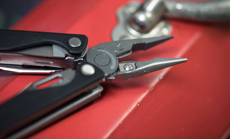 Leatherman charge plus multi-tool on red tool box, open view