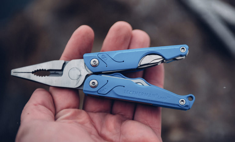 Leatherman blue leap multi-tool in hand, open view