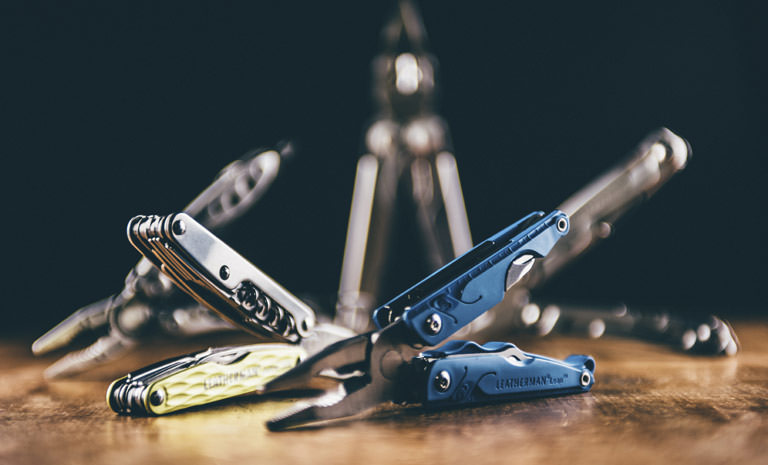 Leatherman blue leap multi-tool on table, open view, 13 tools